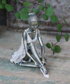 Ballerina, sitting
